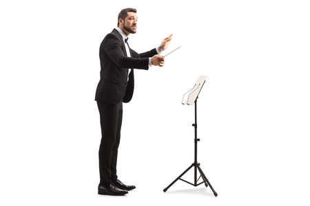 Full length profile shot of a musical conductor with a baton performing isolated on white background