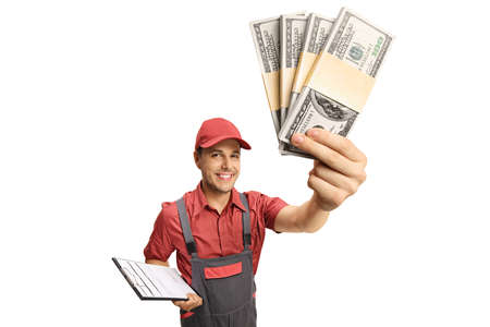 Male courier holding a clipboard and stacks of money isolated on white background