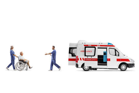 Nurse pushing an elderly patient in a wheelchair towards an ambulance and a male doctor greeting them isolated on white background Stock Photo