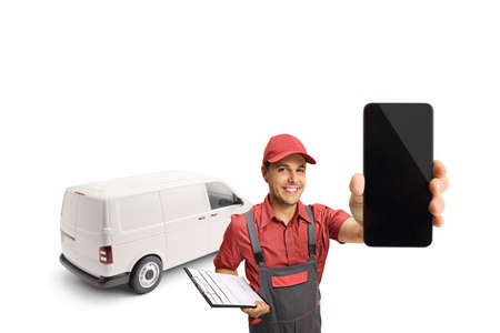 Delivery guy with a van holding a clipboard and a smartphone isolated on white background