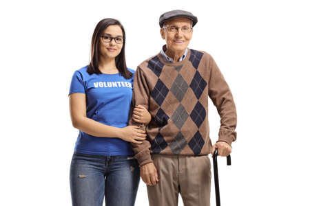 Woman volunteer standing with a senior male pensioner with a walking cane isolated on white background