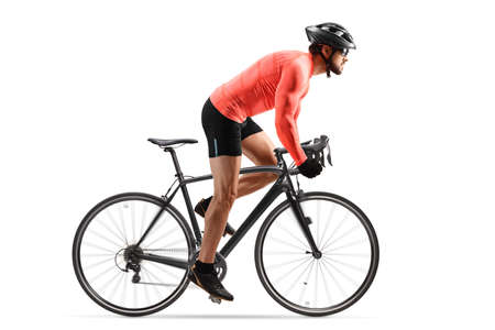Cyclist with helmet and sunglasses riding a bicycle out of the saddle isolated on white background
