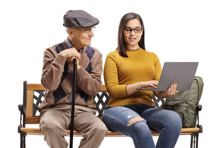 Elderly man and female student with a laptop sitting on a bench isolated on white background