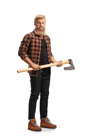 Full length portrait of a casual bearded man holding a hatchet isolated on white background