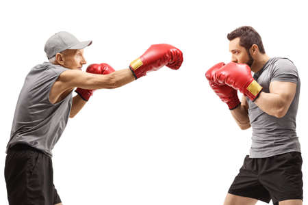 Elderly man and a young man boxing isolated on white background