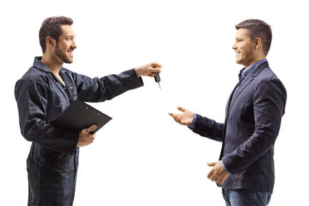 Mechanic holding a clipboard and giving keys to a customer isolated on white background