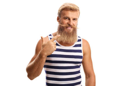 Cheerful blond guy pointing at his beard and moustaches isolated on a white background