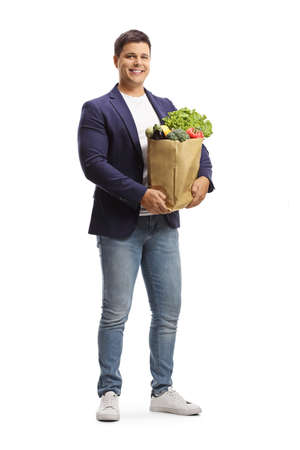 Full length portrait of a smiling man with a grocery bag isolated on white background