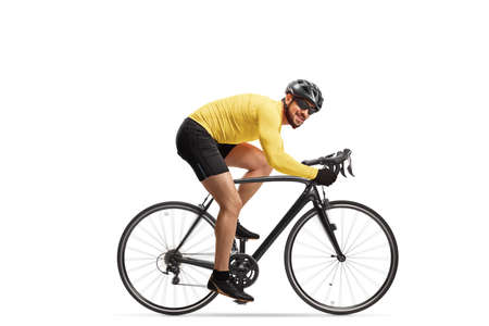 Full length shot of a professional male cyclist with a helmet riding a road bicycle isolated on white background
