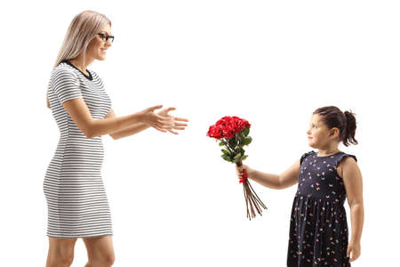 Girl giving red roses to a young woman isolated on white background Reklamní fotografie