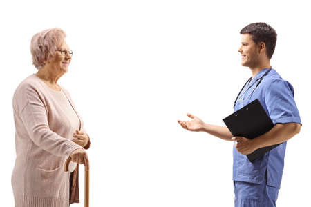 Doctor explaining and gesturing with an elderly female patient isolated on white background