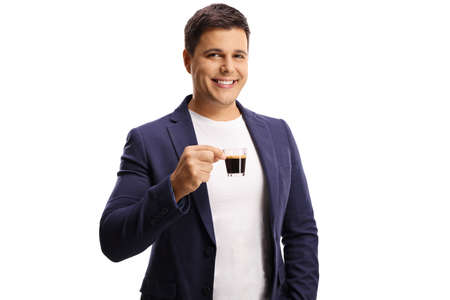 Smiling young man holding an espresso cup isolated on white background