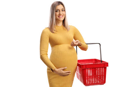 Full length shot of a happy pregnant woman holding an empty shopping basket isolated on white background
