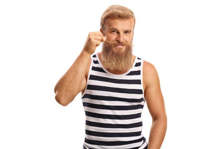 Bearded guy holding his moustaches and smiling isolated on a white background