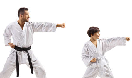 Boy practicing karate with instructor isolated on white background