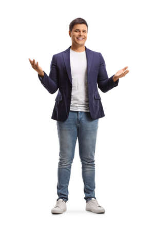 Full length portrait of a happy young man in jeans and suit gesturing with hands isolated on white background
