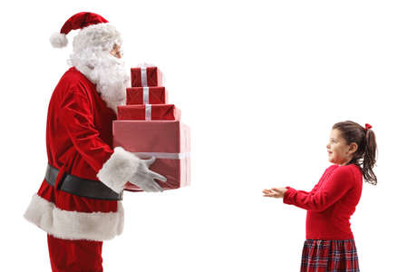 Santa giving presents to a happy little girl isolated on white background Reklamní fotografie