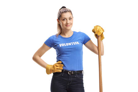 Young female volunteer standing with a shovel isolated on white background Reklamní fotografie