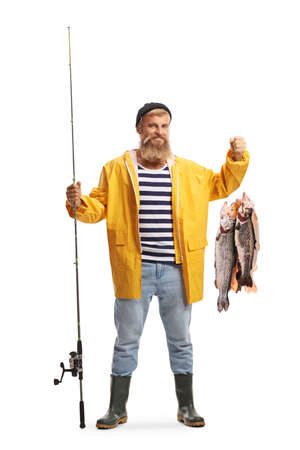 Full length portrait of a fisherman in a yellow rain coat holding a fishing pole and fish isolated on white background