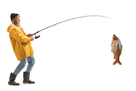 Full length profile shot of a bearded fisherman catching a big fish isolated on white background