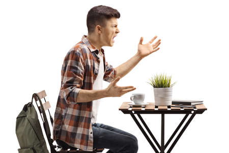 Angry guy in a cafe shouting isolated on white background Reklamní fotografie