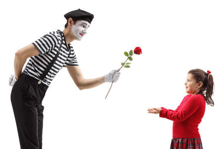 Mime giving a red rose to a little girl isolated on white background