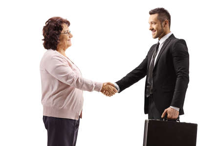 Elderly woman shaking hands with a young businessman with a briefcase isolated on white background
