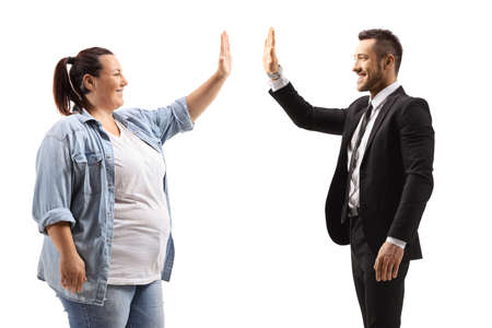 Corpulent woman high-fiving a man in a suit isolated on white background