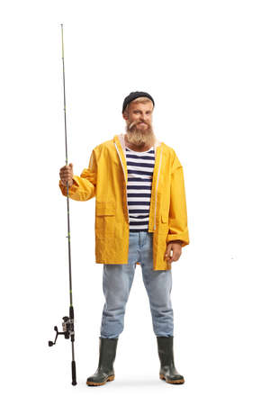 Full length portrait of a bearded young fisherman holding a fishing rod and smiling isolated on white background