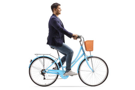 Profile shot of a young man riding a blue bicycle isolated on white background Reklamní fotografie