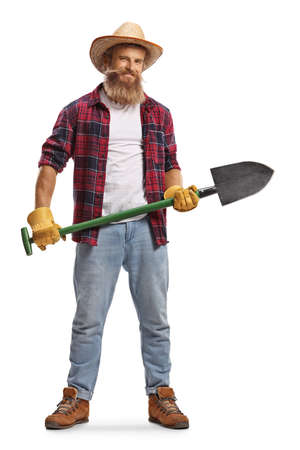 Full length portrait of a bearded farmer with a shovel isolated on white background