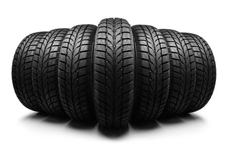 Row of car tires isolated on white background