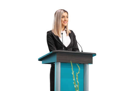 Young professional woman giving a speech on a pedestal isolated on white background Standard-Bild