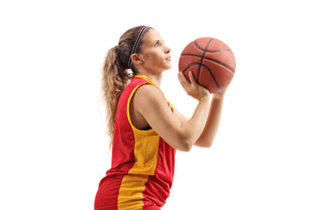 Female basketball player shooting a ball isolated on white background