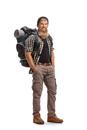 Full length portrait of a young bearded hiker with a backpack looking at camera isolated on white background