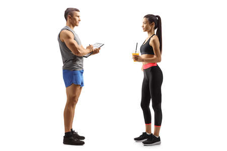 Personal trainer and a young female in sportswear isolated on white background
