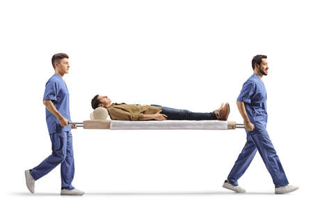 Male health workers carrying young male patient on a stretcher isolated on white background