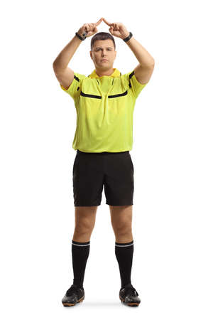 Full length portrait of football referee gesturing a VAR symbol isolated on white background