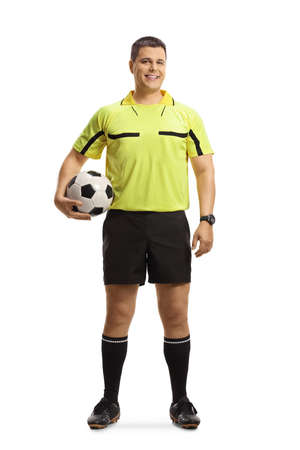 Full length portrait of a referee holding a football isolated on white background