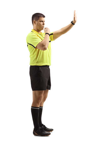 Football referee blowing a whistle and gesturing stop with hand isolated on white background