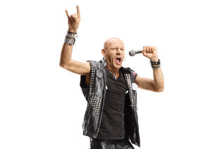 Male rock singer with a microphone gesturing a sign isolated on white background