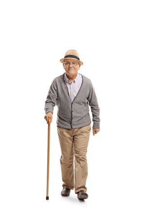 Full length portrait of an elderly gentleman with a cane walking and smiling isolated on white background