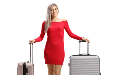 Woman in a red dress with suitcases isolated on white abackground