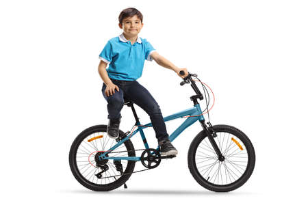Little boy sitting on a bicycle and looking at the camera isolated on white background