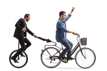 Man on a bicycle pulling another man with a tricycle and umbrella isolated on white background