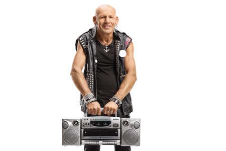 Punk rocker in leather outfit holding a boombox radio isolated on white background