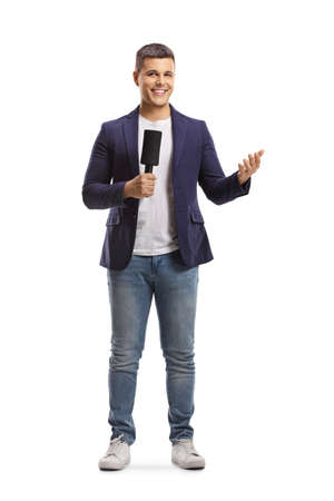 Full length portrait of male reporter holding a microphone and gesturing with hand isolated on white background