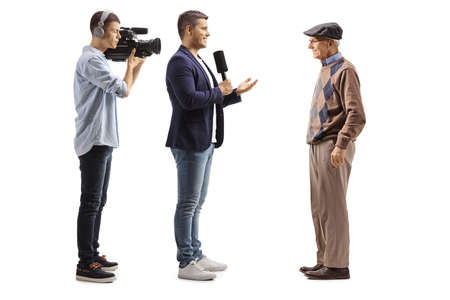 Videographer and a male reporter interviewing an elderly man isolated on white background