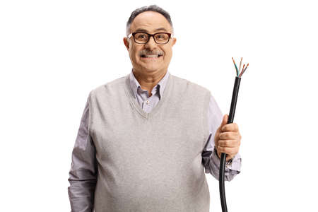 Guilty mature man holding a broken elecrtic cable isolated on white background