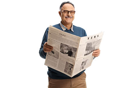 Cheerful mature man holding a newspaper and smiling isolated on white background Stockfoto